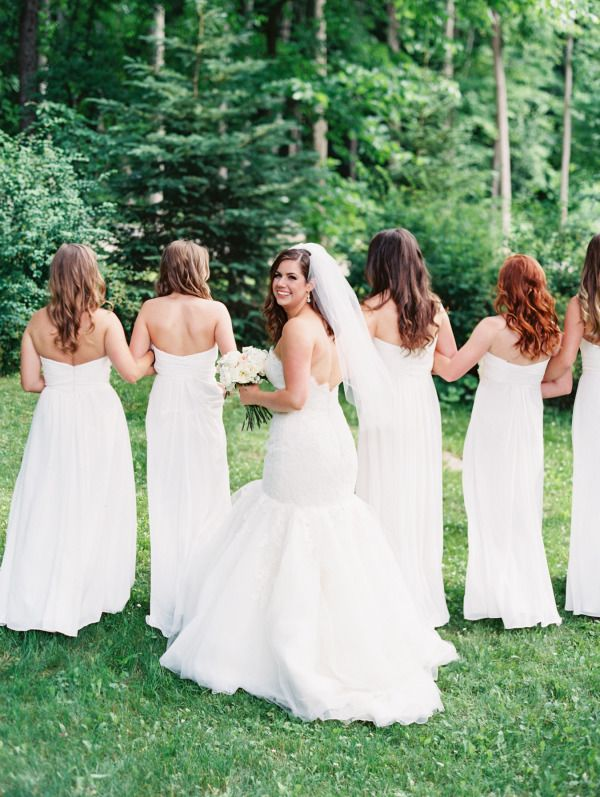 Gorgeous white dresses: http://www.stylemepretty.com/2015/07/06/all-chic-all-white-bridal-party-inspiration/