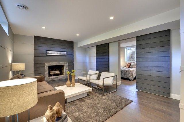 Modern Basement Design By Minneapolis STR8 Modern General Contracting U0026  Real Estate, LLC Note Fireplace And Sliding Door