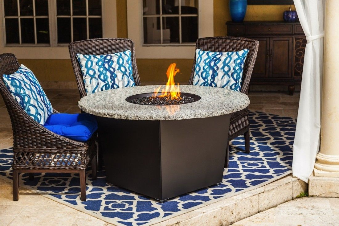 With its smooth and round design the Riviera fire pit table melds