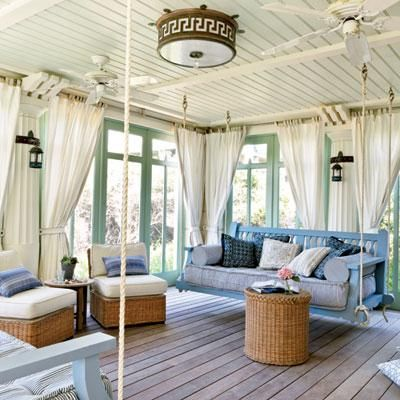 With a soft green and blue color palette, a nautical rope swing, and seagrass furniture, this dreamy porch is soaked in seaside style. Coastalliving.com