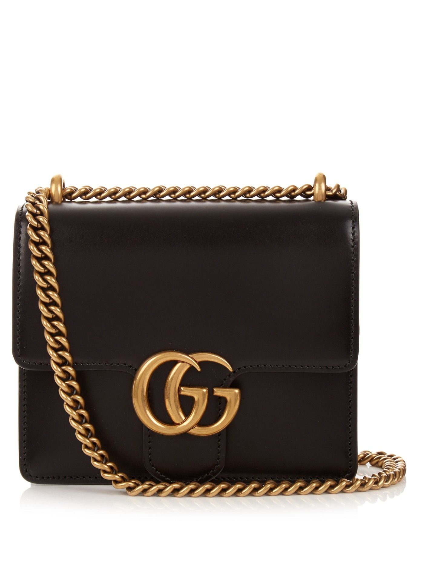 f171dd4574d Gucci s black smooth-leather GG Marmont bag subtly plays to the 1970s feel  of the label s new collection.