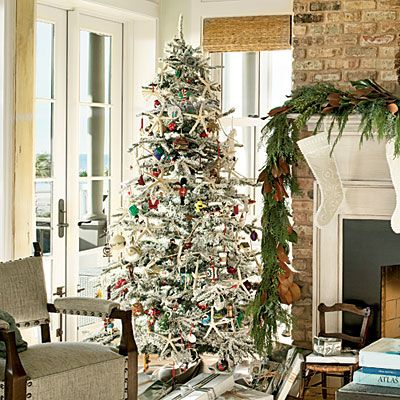 a flocked tree paired with an evergreen and magnolia garland has a festive traditional look