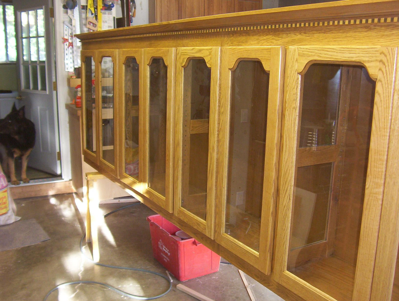 Display feature glass in red oak arched frames