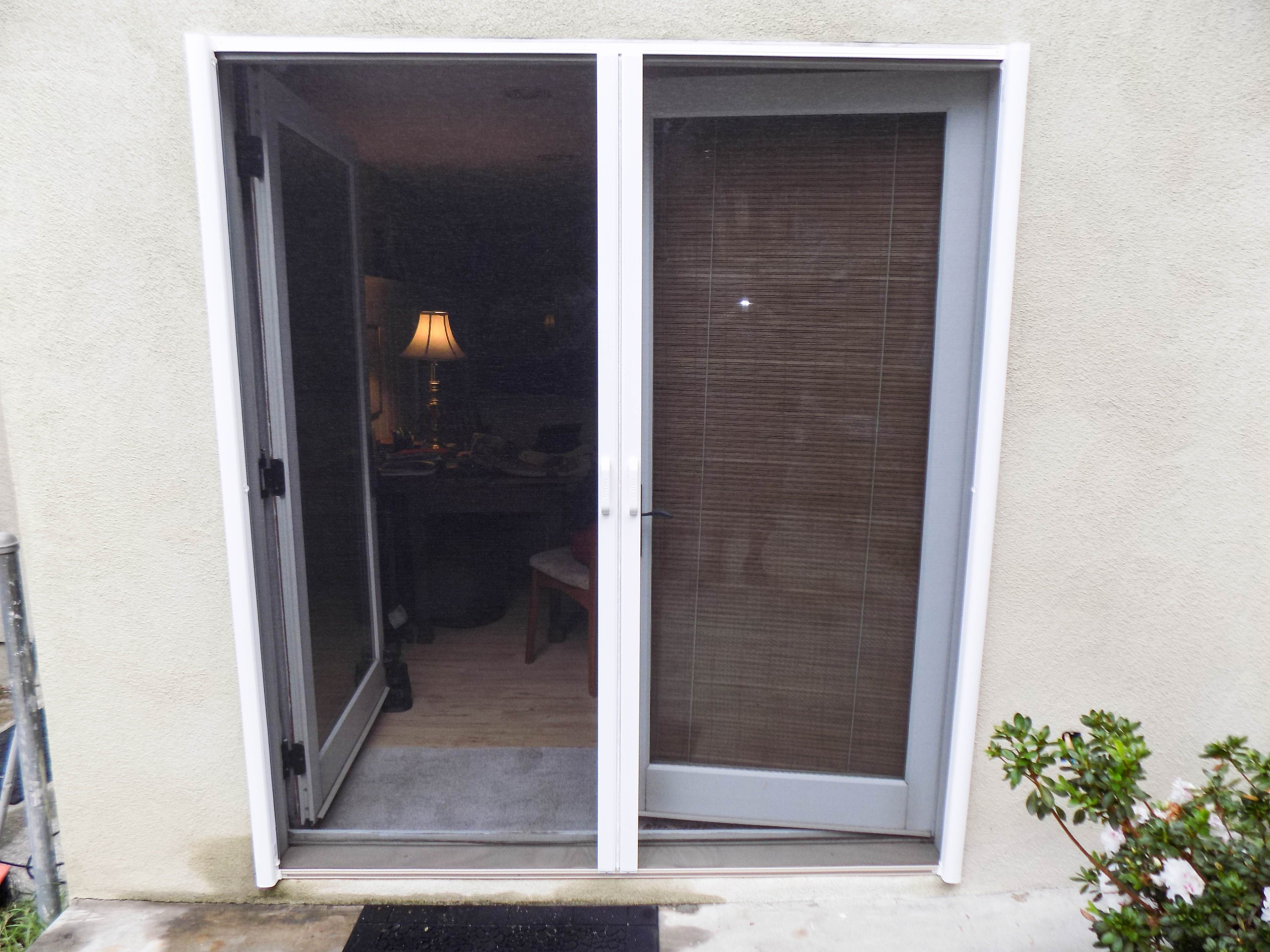Check Out This Installation Of White Framed Double Stowaway Retractable Screen Doors Over A Set Of Back Retractable Screen Door French Doors Retractable Screen