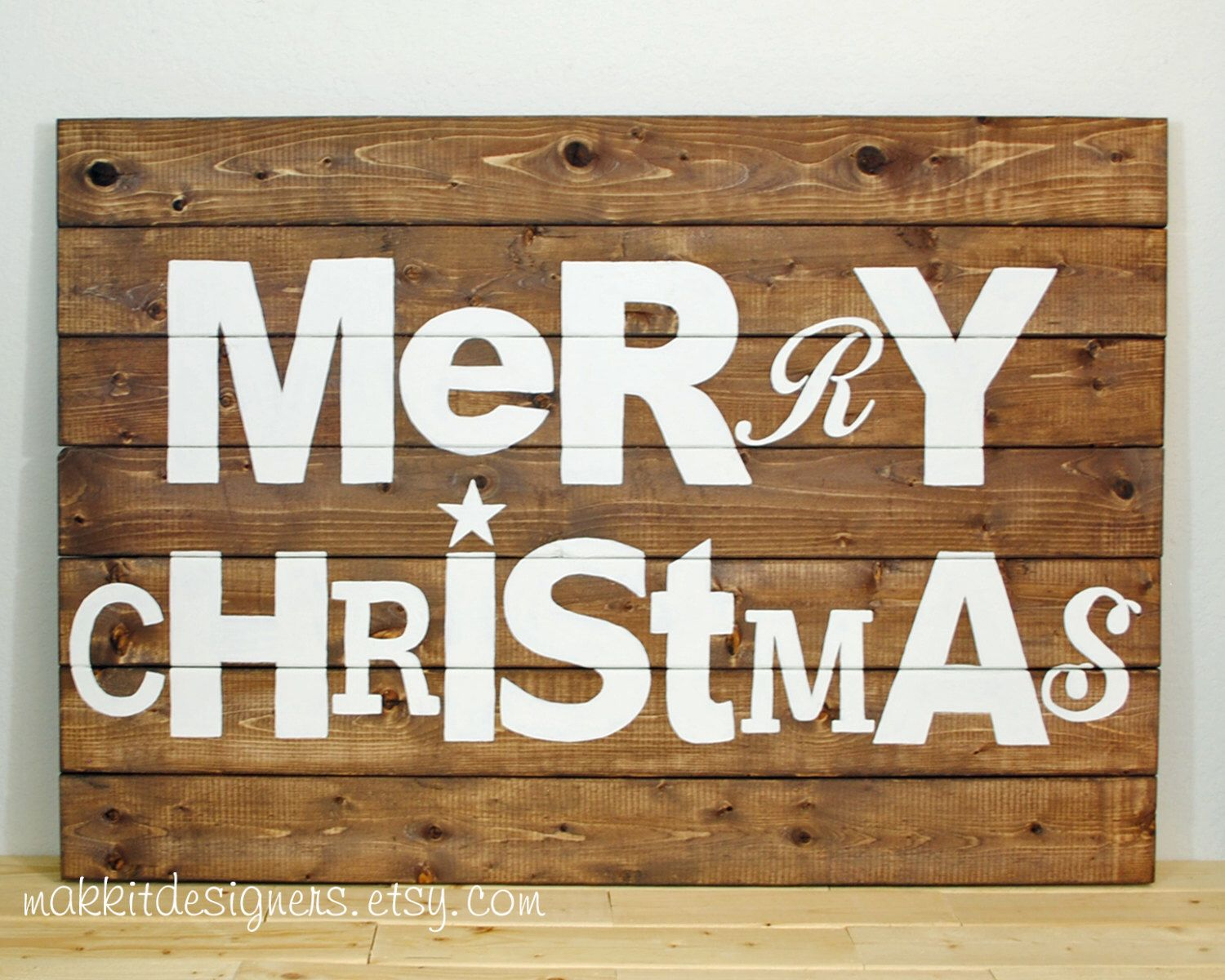 A personal favorite from my Etsy shop https://www.etsy.com/listing/481305340/rustic-pallet-wood-merry-christmas-sign