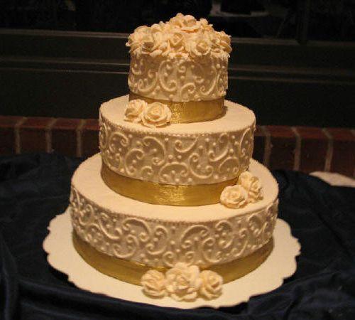 White Wedding Cake With Gold Bling