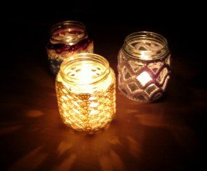 Pretty shadows from these crochet jar candle covers
