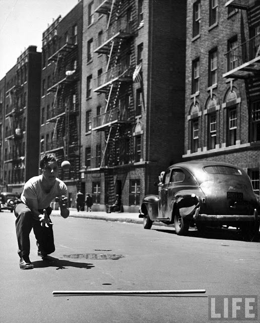 Young boy poised to catch ball at home plate (the manhole cover) in a game of stickball. Taken by LIFE photographer Ralph Morse around streets of New York City in June, 1947vintage everyday: 18 Glorious Vintage Photos Capture Kids Playing on the Streets of New York City in the 1940s