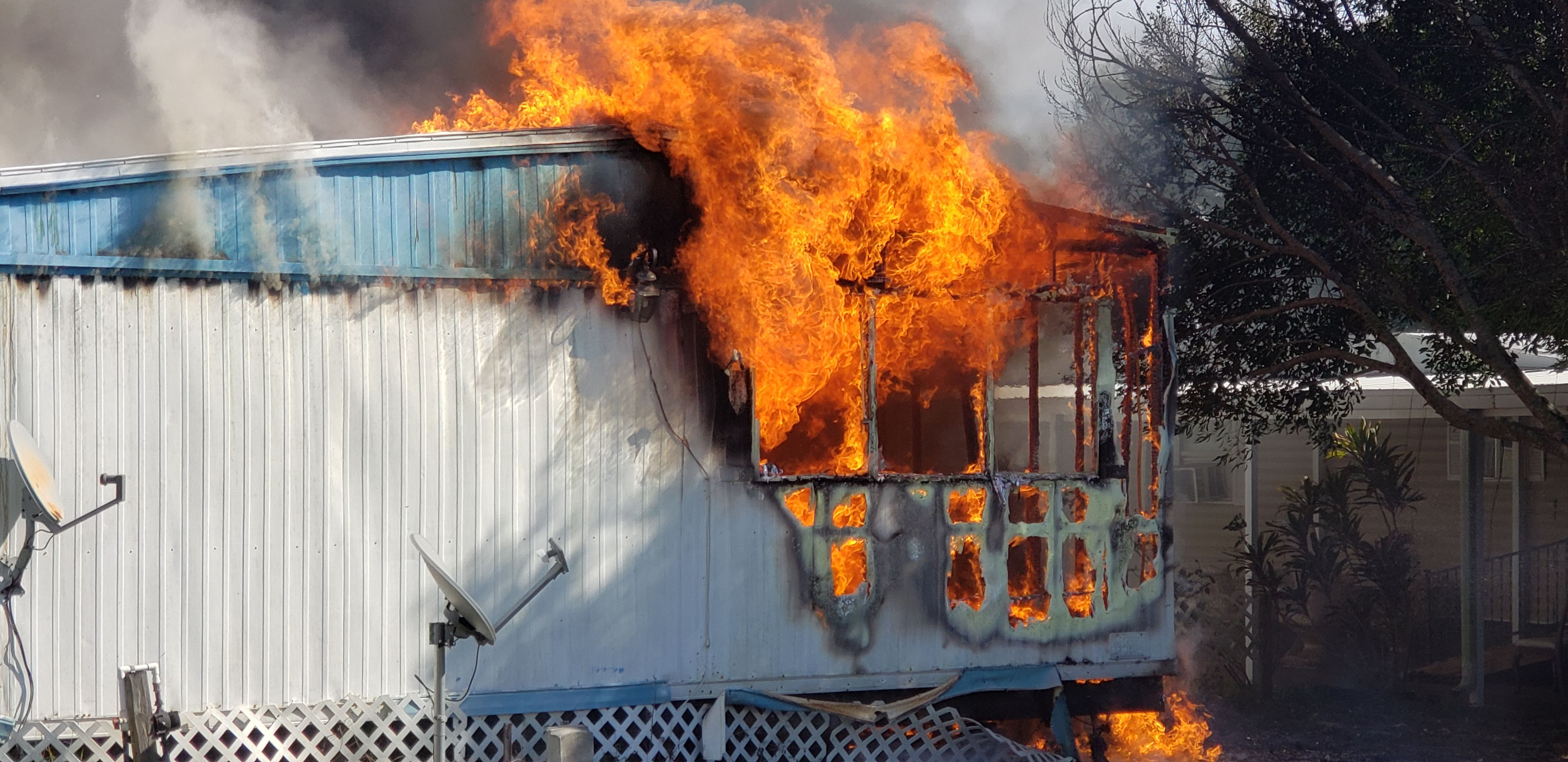 A mobile home caught fire, in Largo, Florida. Everything