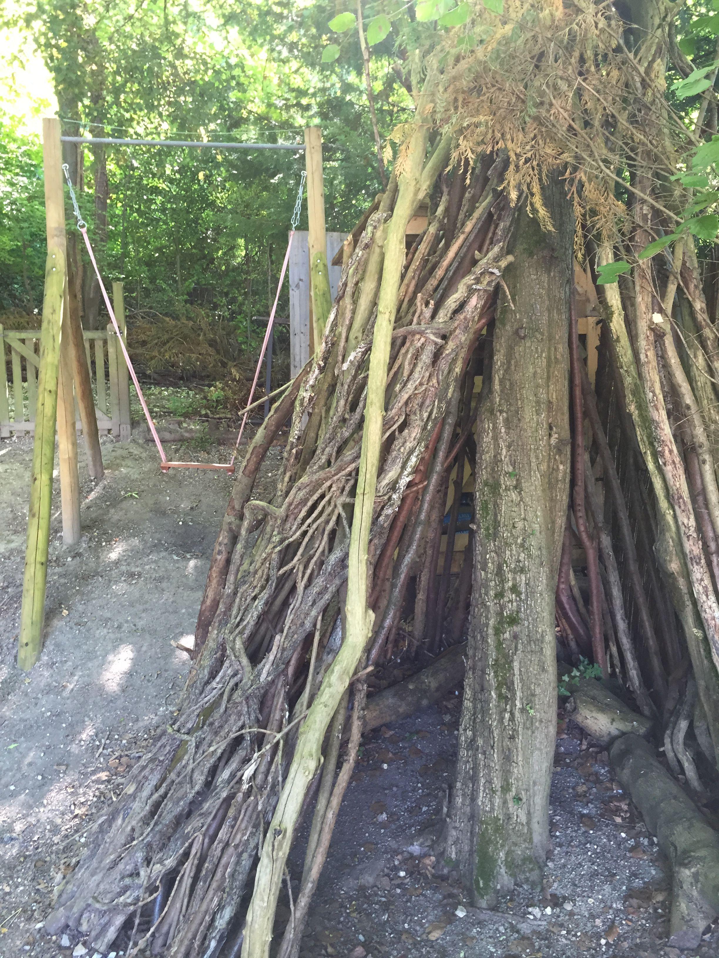 Wooden swing and den in childrenus garden our garden by the woods