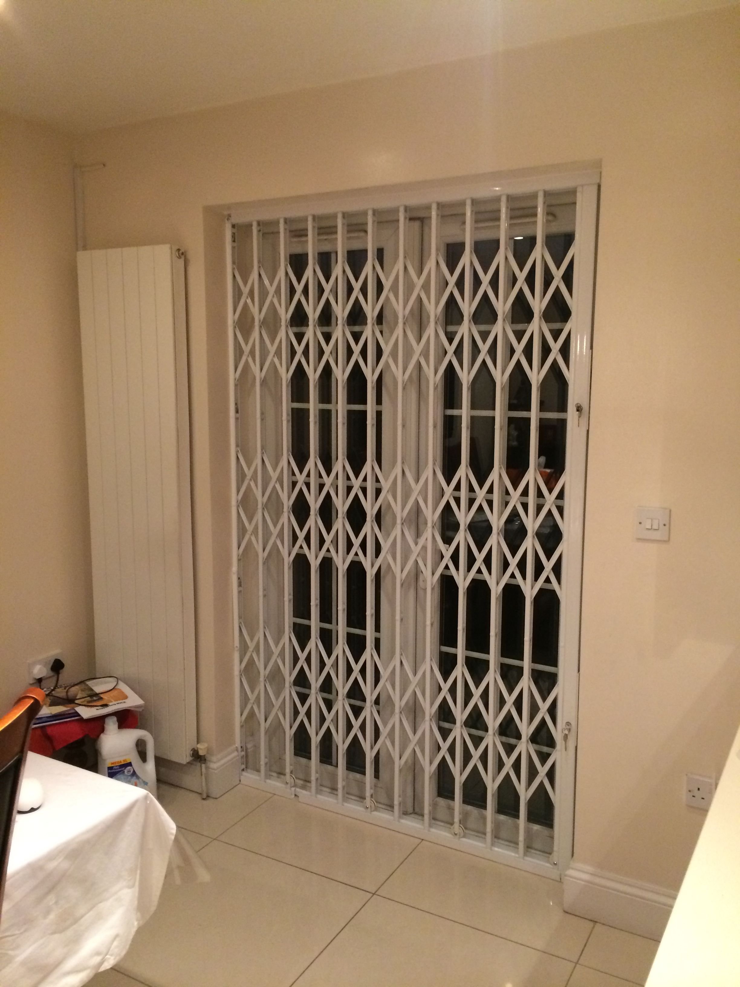RSG1000 retractable patio door security grilles fitted to a