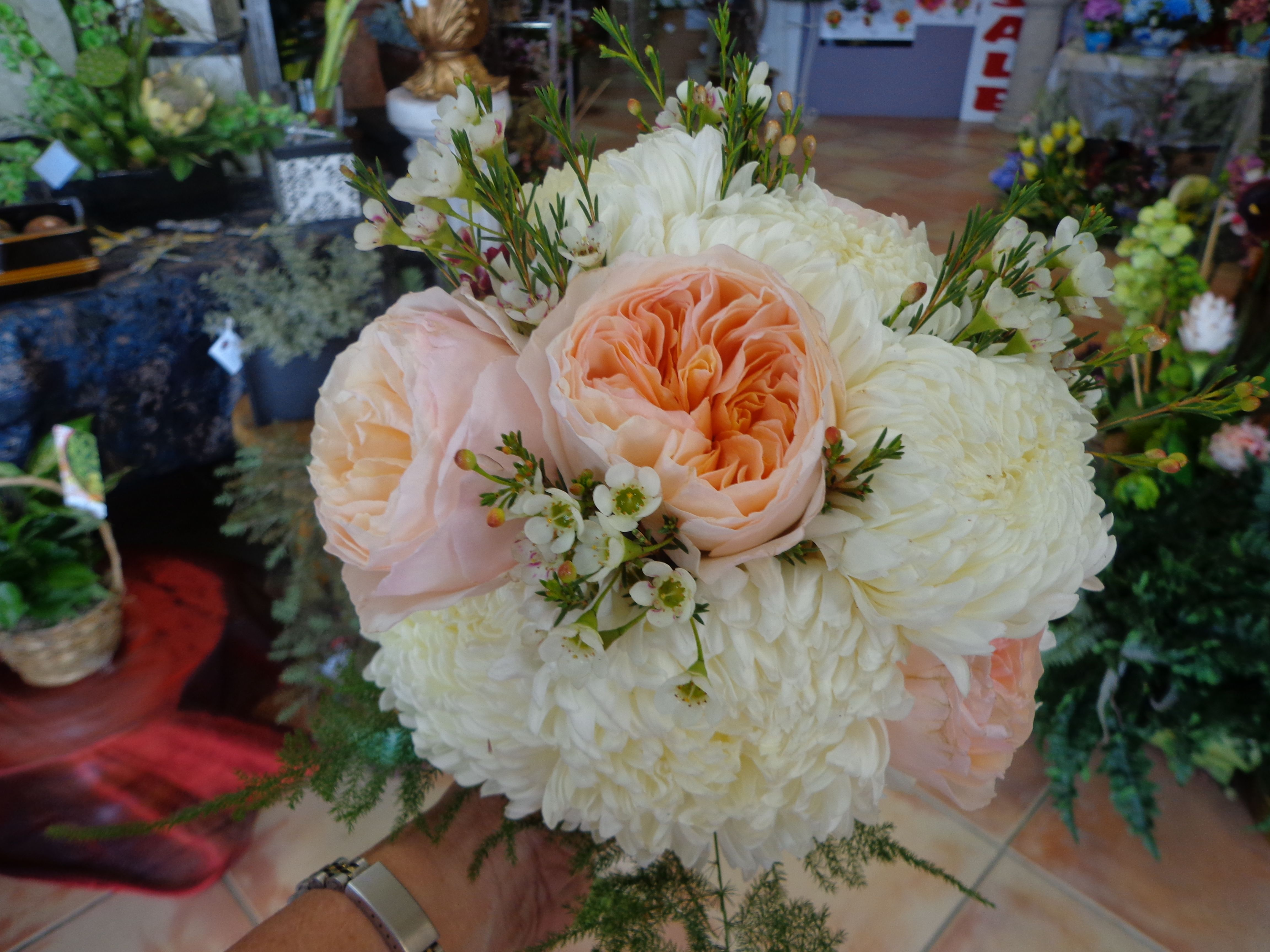 bridal bouquet of white football mums and peach garden roses