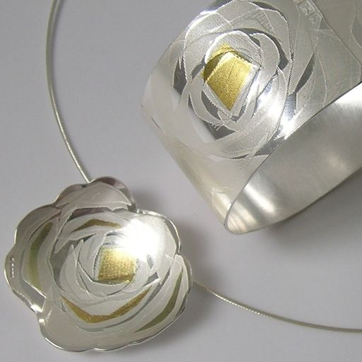 Full Bloom Flower on silver torque   Contemporary Necklaces / Pendants by contemporary jewellery designer JESSICA BRIGGS-UK