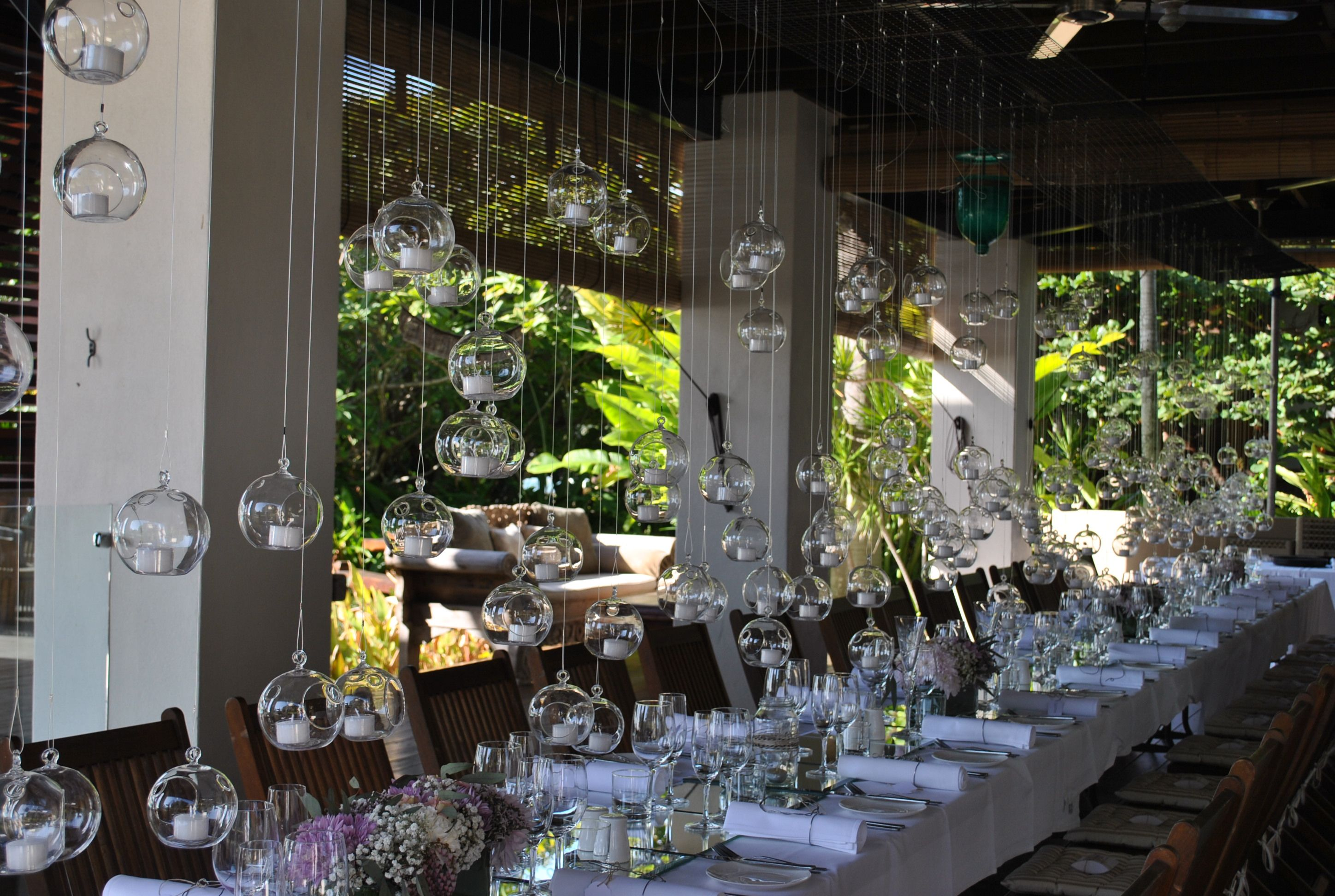 200 Votives suspended above the dining table made for a
