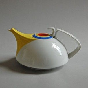 Teapot, with removable porcelain strainer; part of tea set 'Bauhaus Hommage I'; hard-paste porcelain; glazed white with yellow spout and decorated with red, yellow and blue concentric circles; factory marks on the base. #teapotset