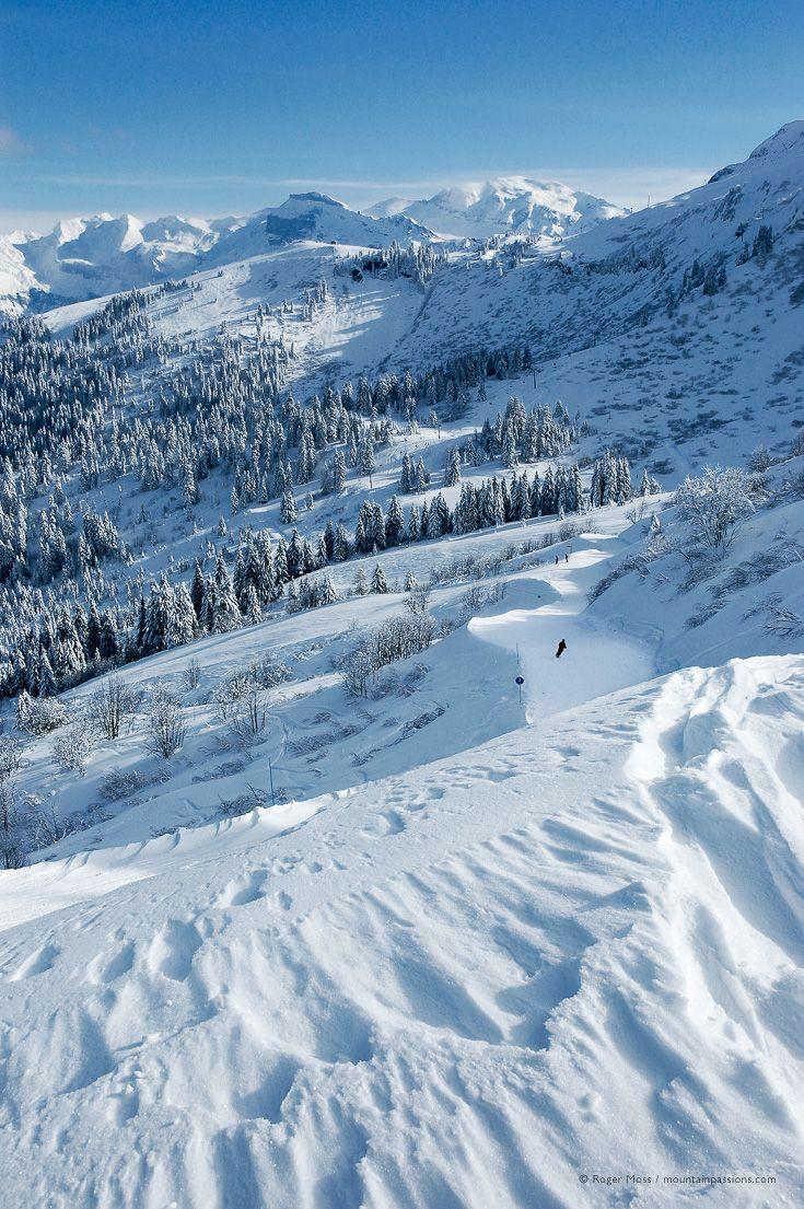 skier heading for samoëns 1600, grand massif ski area, haute-savoie