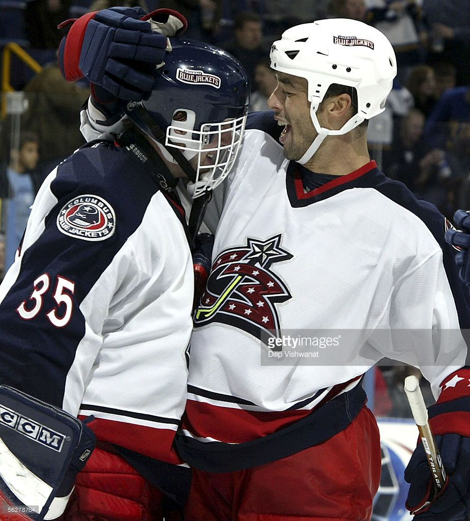 Manny Malhotra #27 of the Columbus Blue Jackets congratulates teammate goalie Martin Prusek #35 after defeating the St. Louis Blues at Savvis Center on November 26, 2005