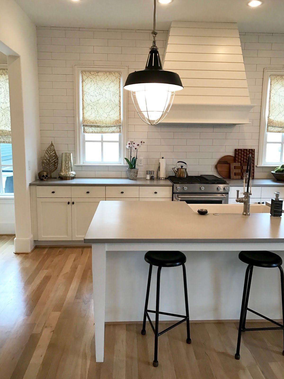 White cabinets, gray counters, tucked in stools