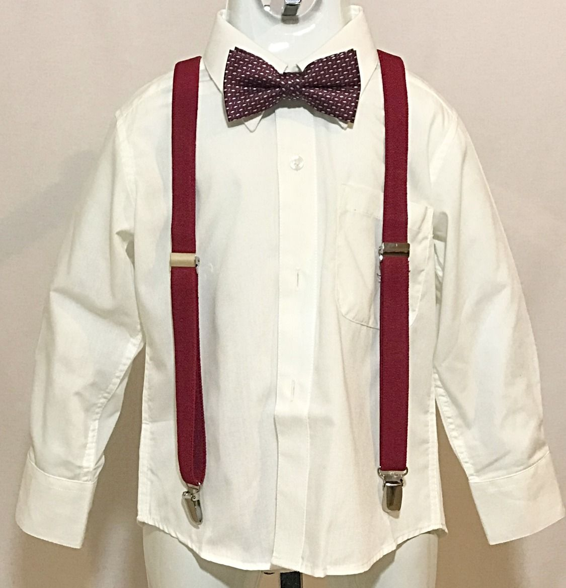 Off white long sleeve dress shirt with burgundy suspenders