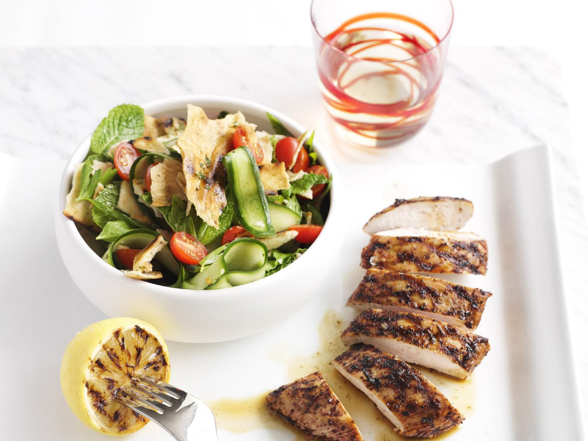 Barbecued chicken with a fresh, herby, minted tomato salad is a weekend lunchtime winner.