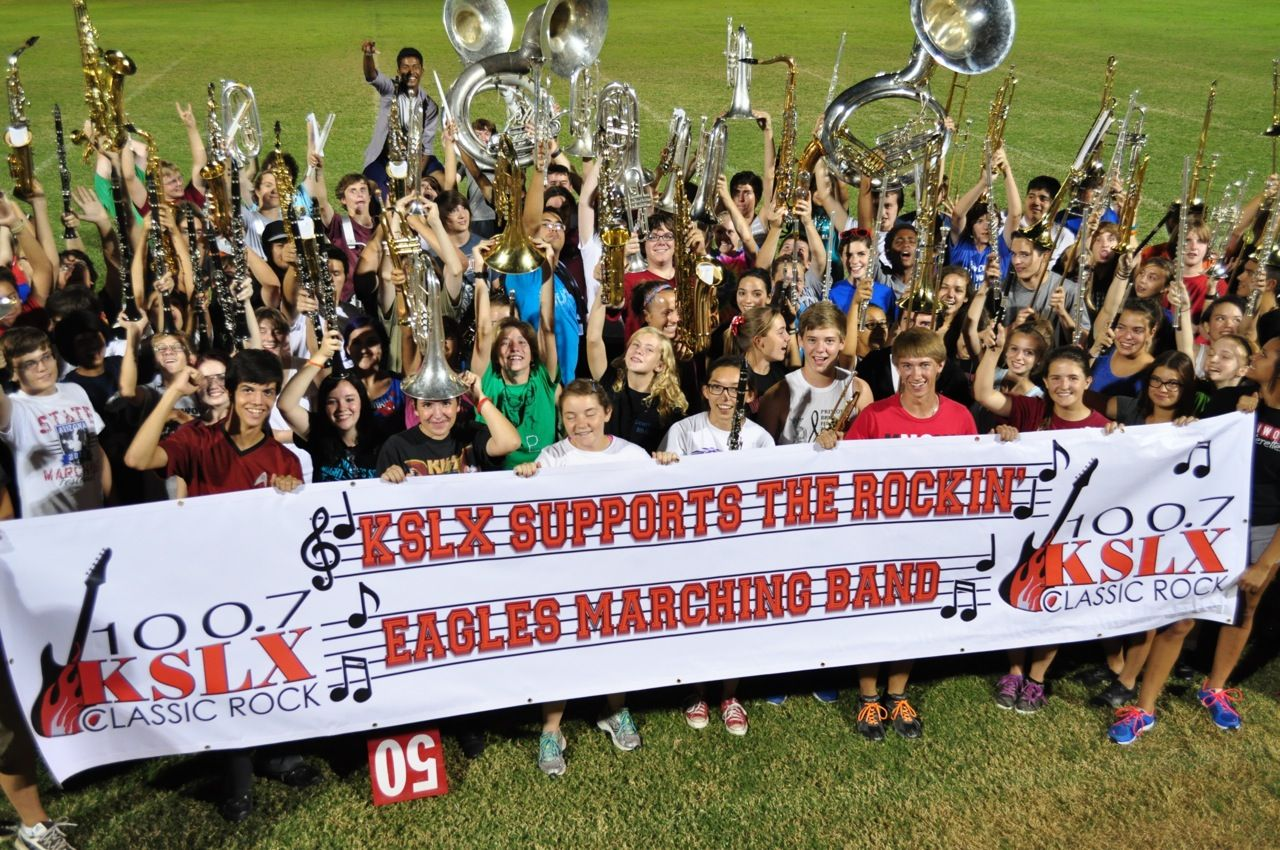 A great photo of the Ironwood High marching band after receiving funds from a local radio station.