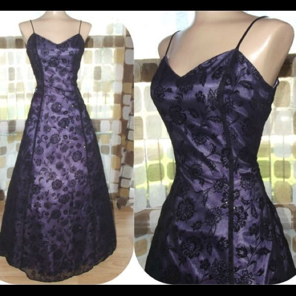 Cute purple dress with black black flower design Prom dress. It was a gift but I couldn't fit it. Zips in back, super cute. There's a slight stain at both armpits, came with them. Any questions please ask Morgan & Co. Dresses Maxi