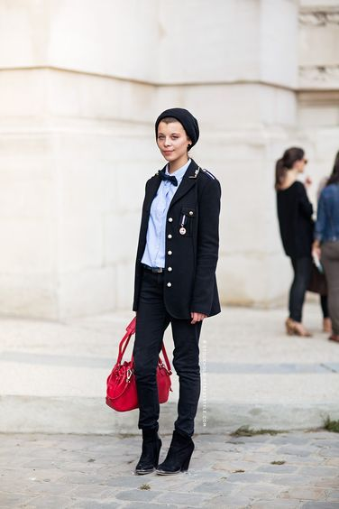 Despite the masculine touches of the military jacket, bow tie and beanie, the purse's pop of color puts some fun into the outfit's edginess. Cute!