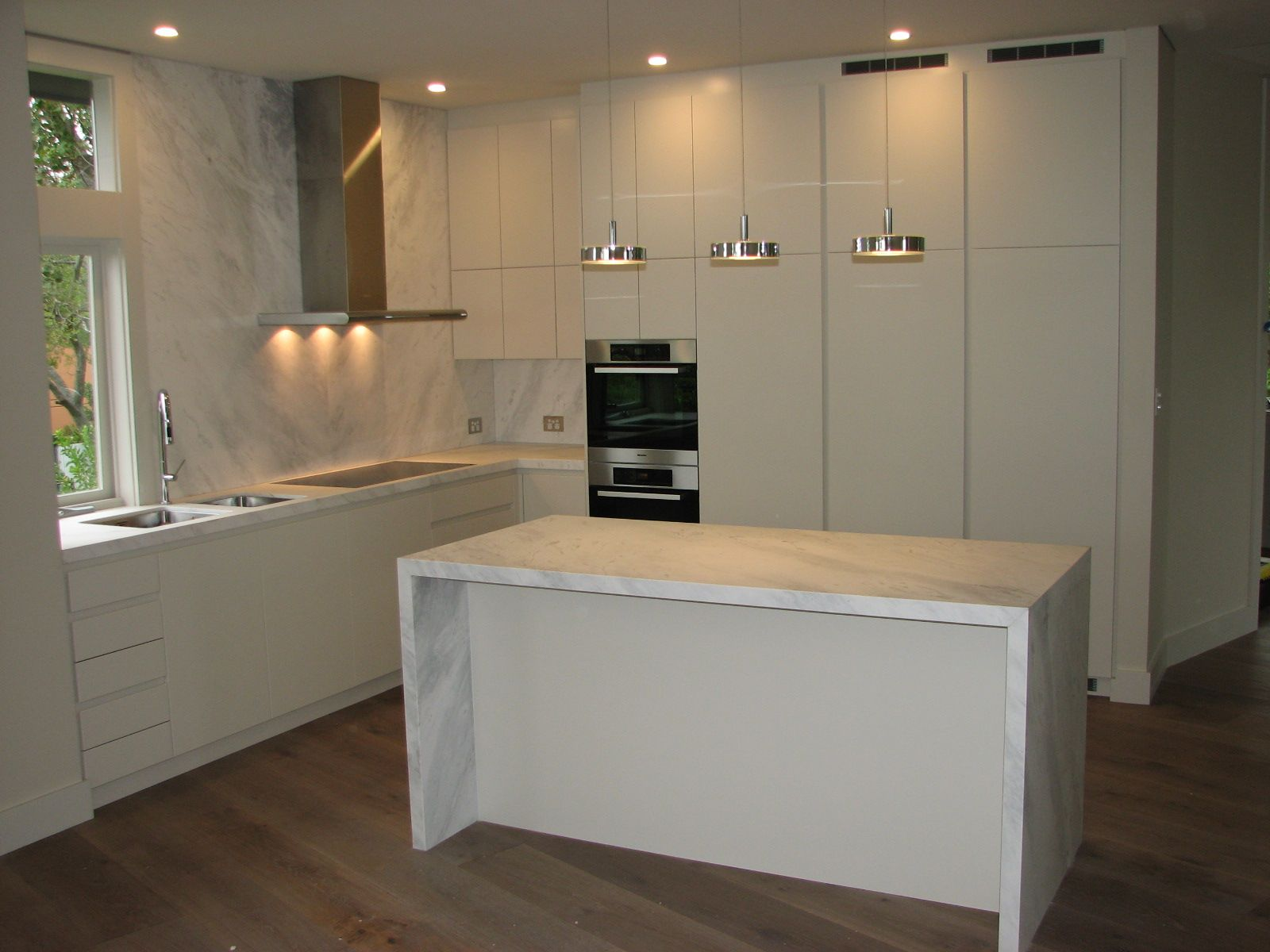 Contemporary Cupboards contemporary design featuring white polyurethane cupboards, finger