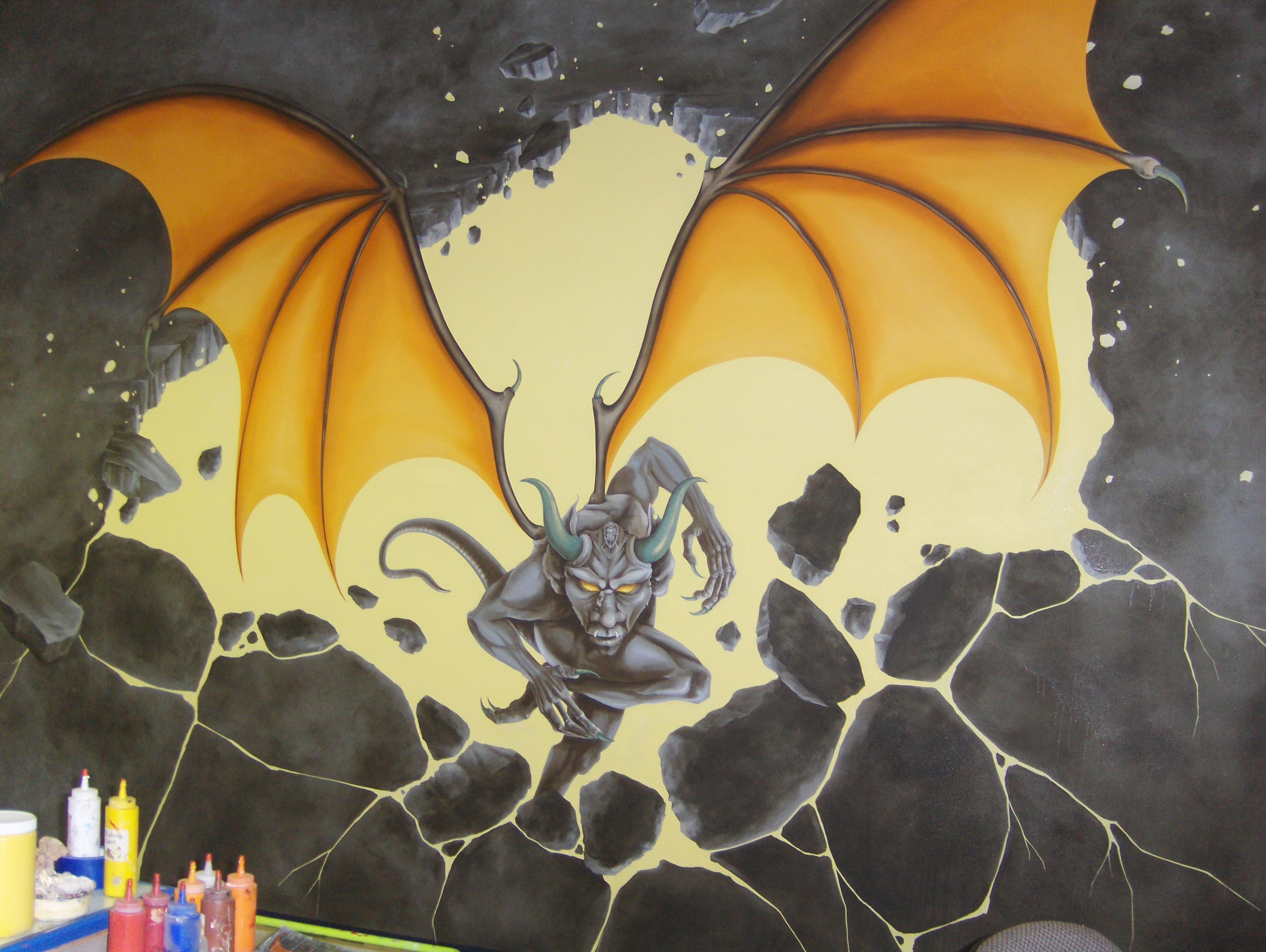 This is a 15' x 12' mural painted on canvas looking for a home. Flames have been added behind the gargoyle.