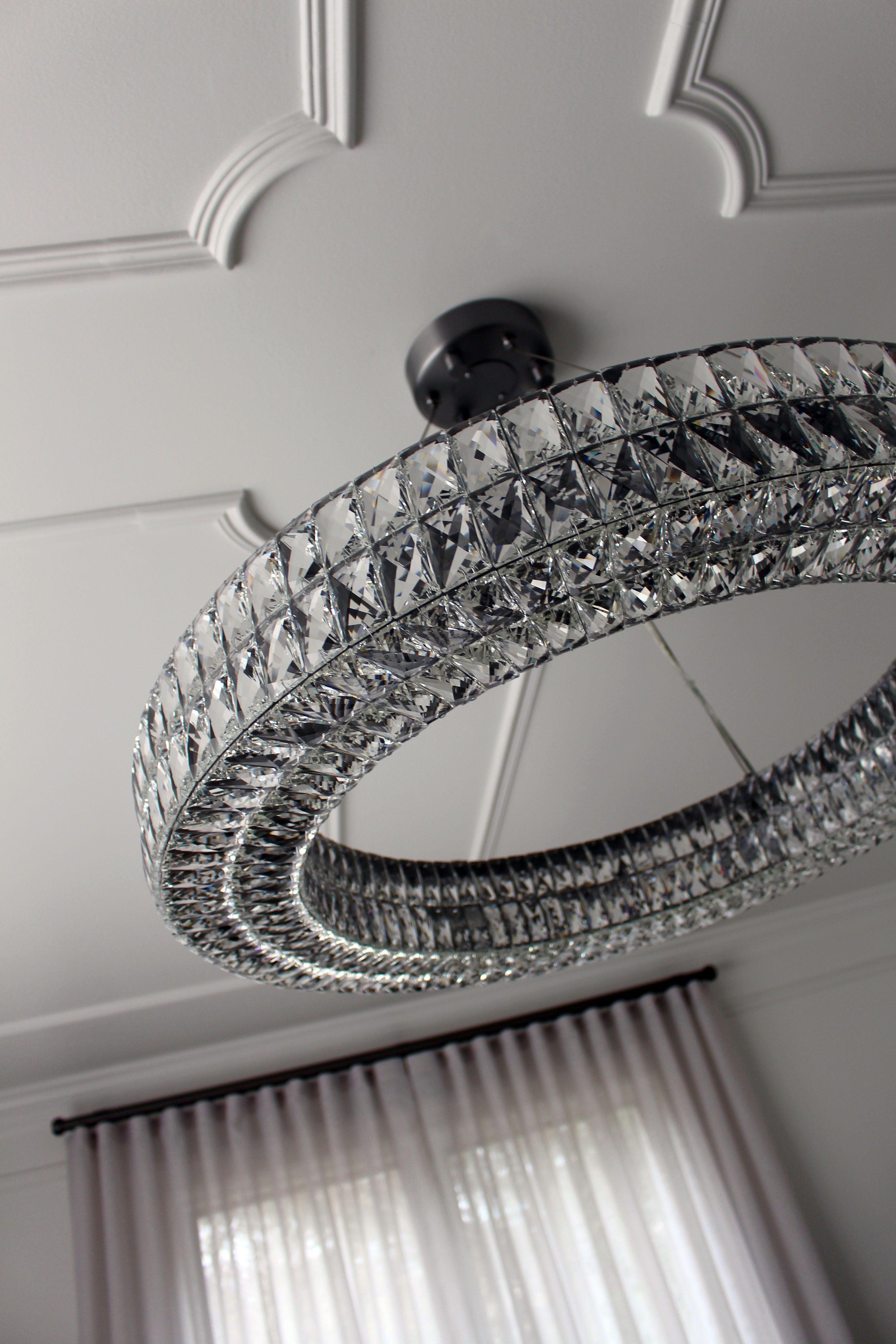 Detail of formal living room ceiling Crystal halo chandelier