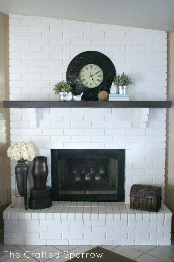 Painted brick fireplace paint brick fireplaces white for Dark fireplace mantel