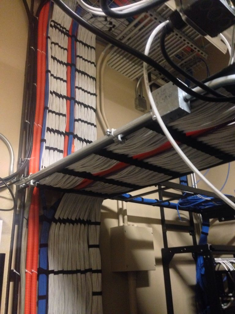 small resolution of over 200 cat 6 ethernet cables running along the wall wire management cable management