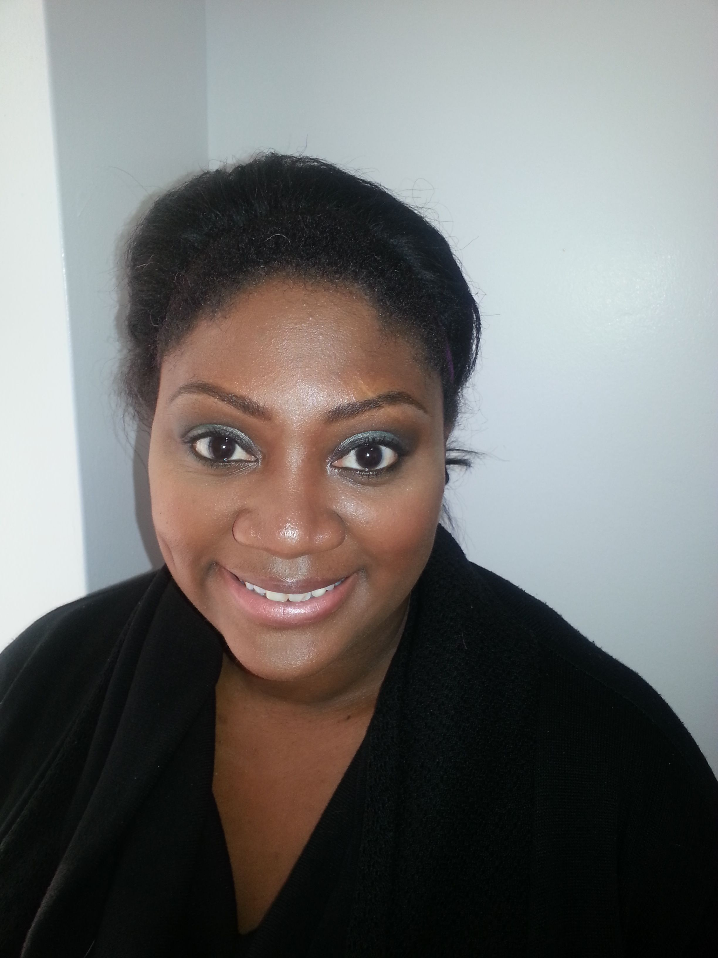 Evening makeup look with a green smokey eye!  My model is looking fantastic!!