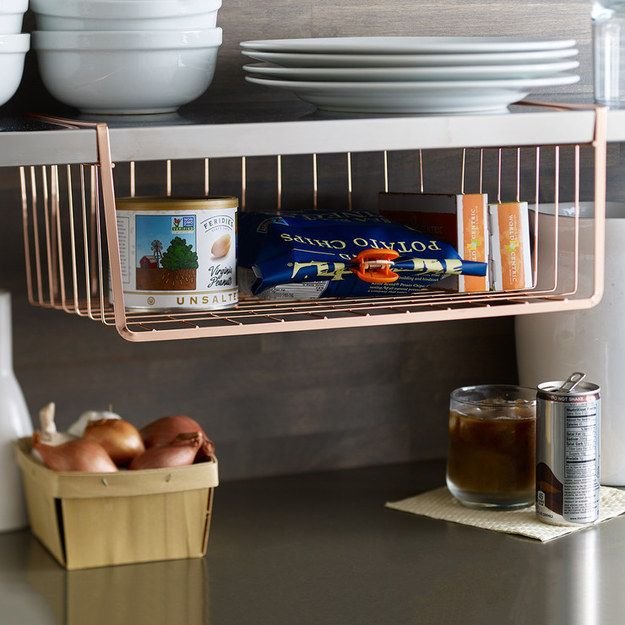 A copper undershelf basket for your kitchen. | 33 Expensive Looking Home Decorations For Under $40