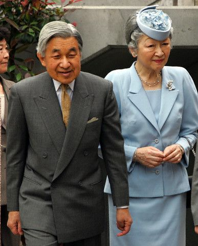 Emperor Akihito and Empress Michiko arrive at Futaba nursery for a visit in Tokyo