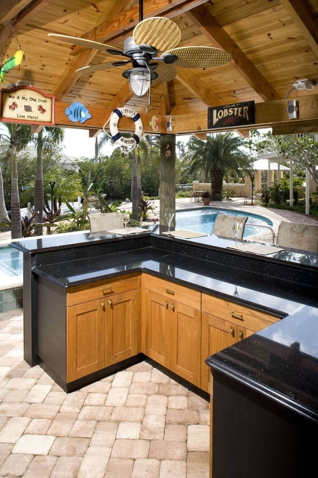 Attractive Outdoor Kitchen Ideas With Ceiling Fans And Black Granite Countertops Using Wooden Cabin Outdoor Kitchen Design Outdoor Kitchen Outdoor Kitchen Bars