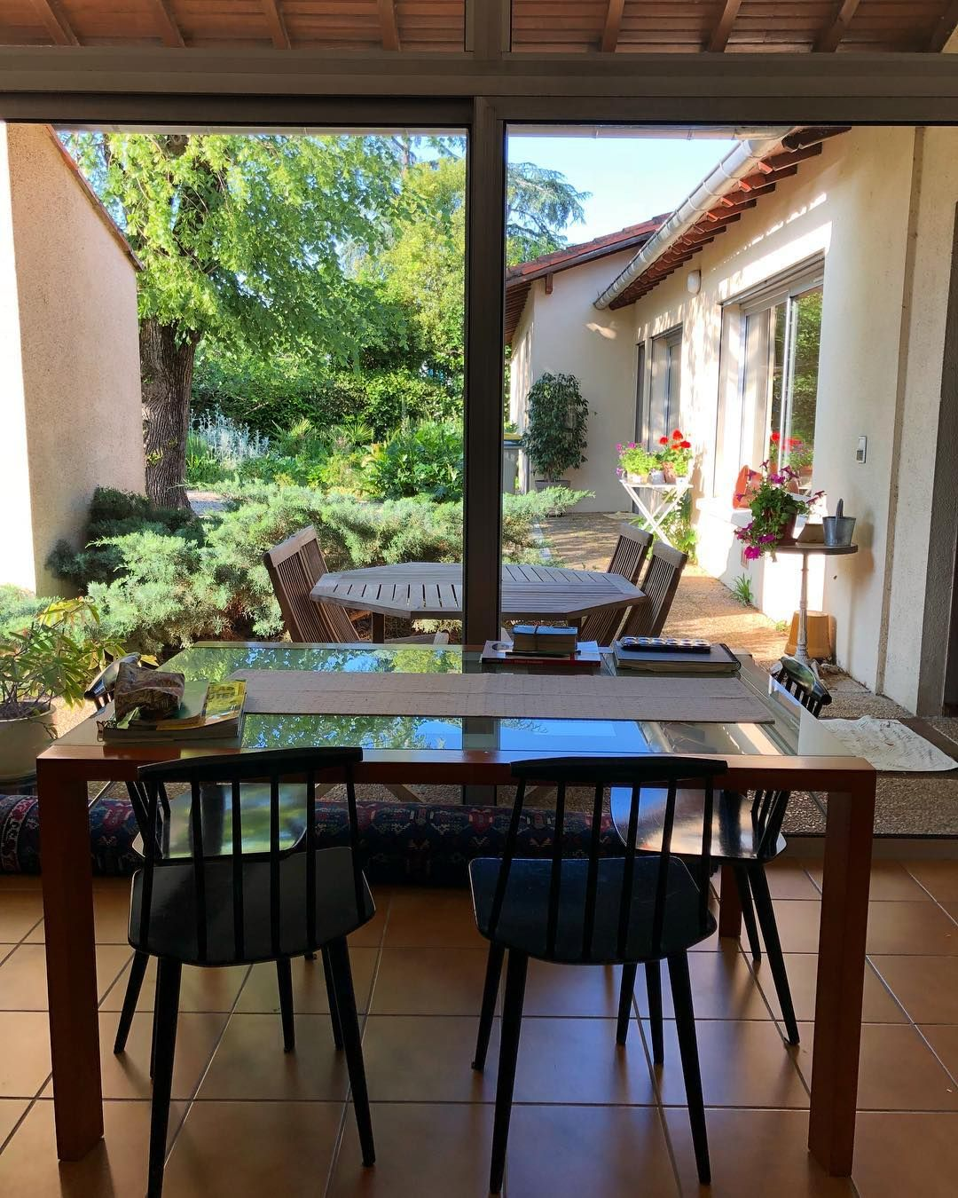 Nigeria house window design  outside seen from inside sittingroom window garden tables