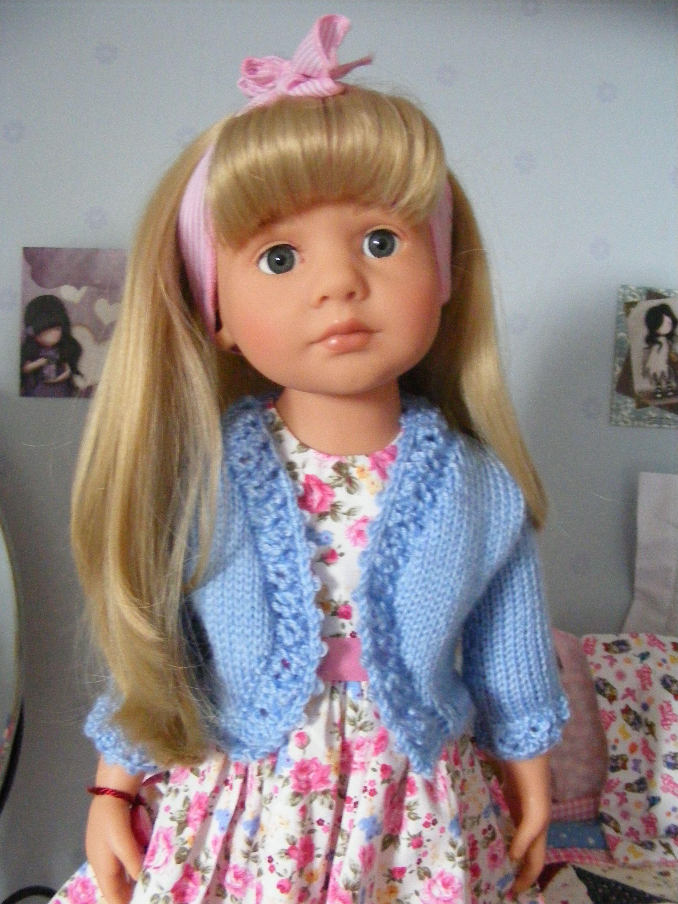 Bolero knitted by me; pattern Debonair Designs. Dress by Vintage Baby