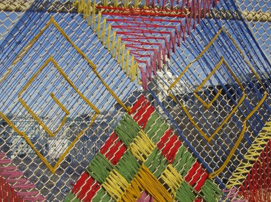 Fence art. Would be nice to use outdoor-appropriate materials and make more permanent.