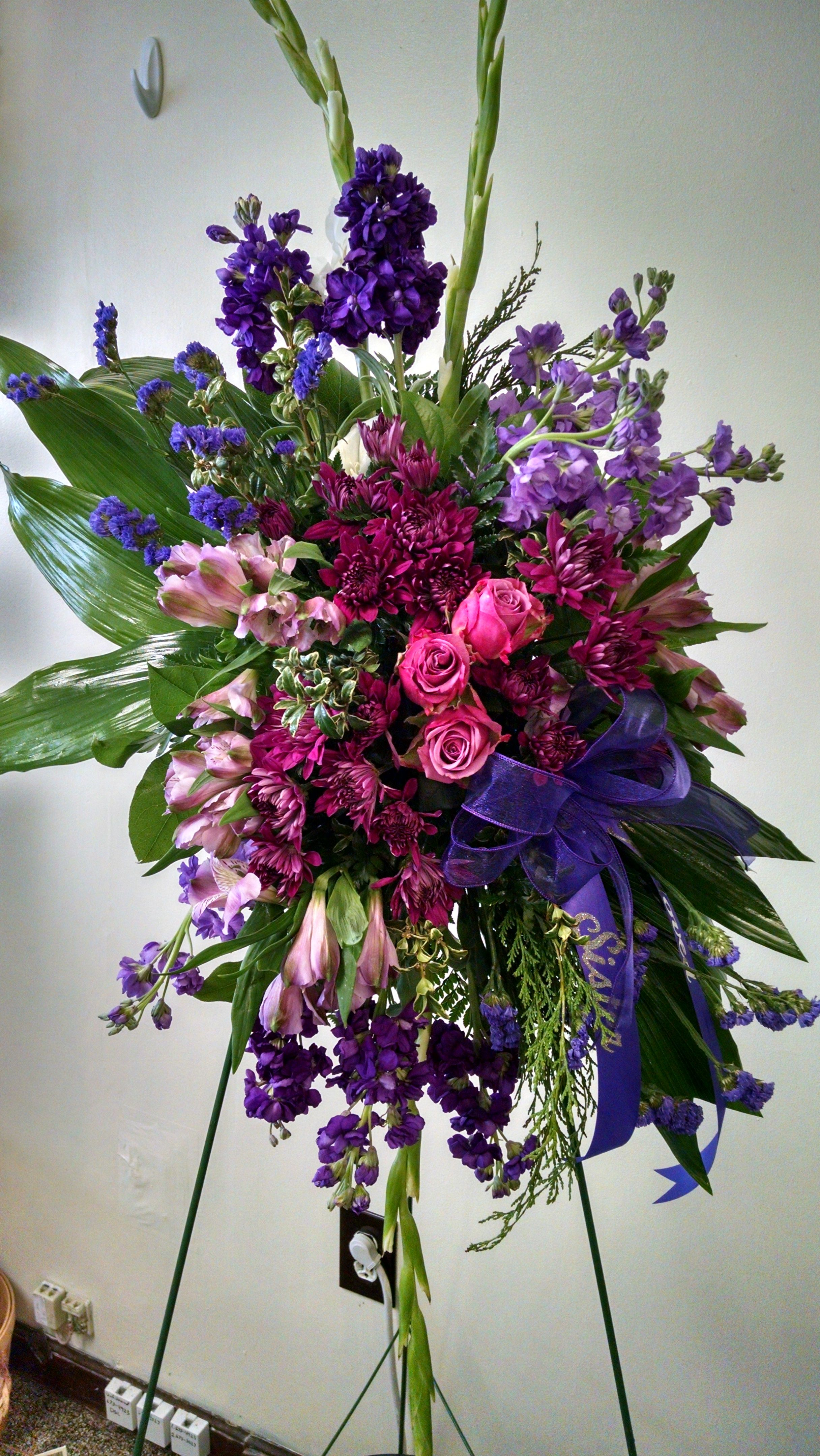 This Standing Spray Features Pink Roses White Gladioli Purple