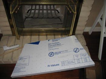 seal up our drafty, non-working fireplace with foam insulation ...