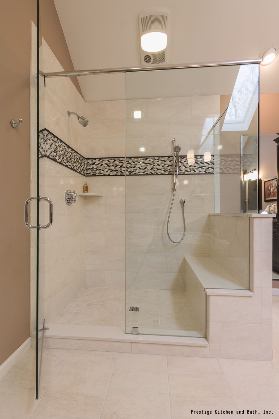 A Gorgeous Shower With Neutral Tile And A Black And White