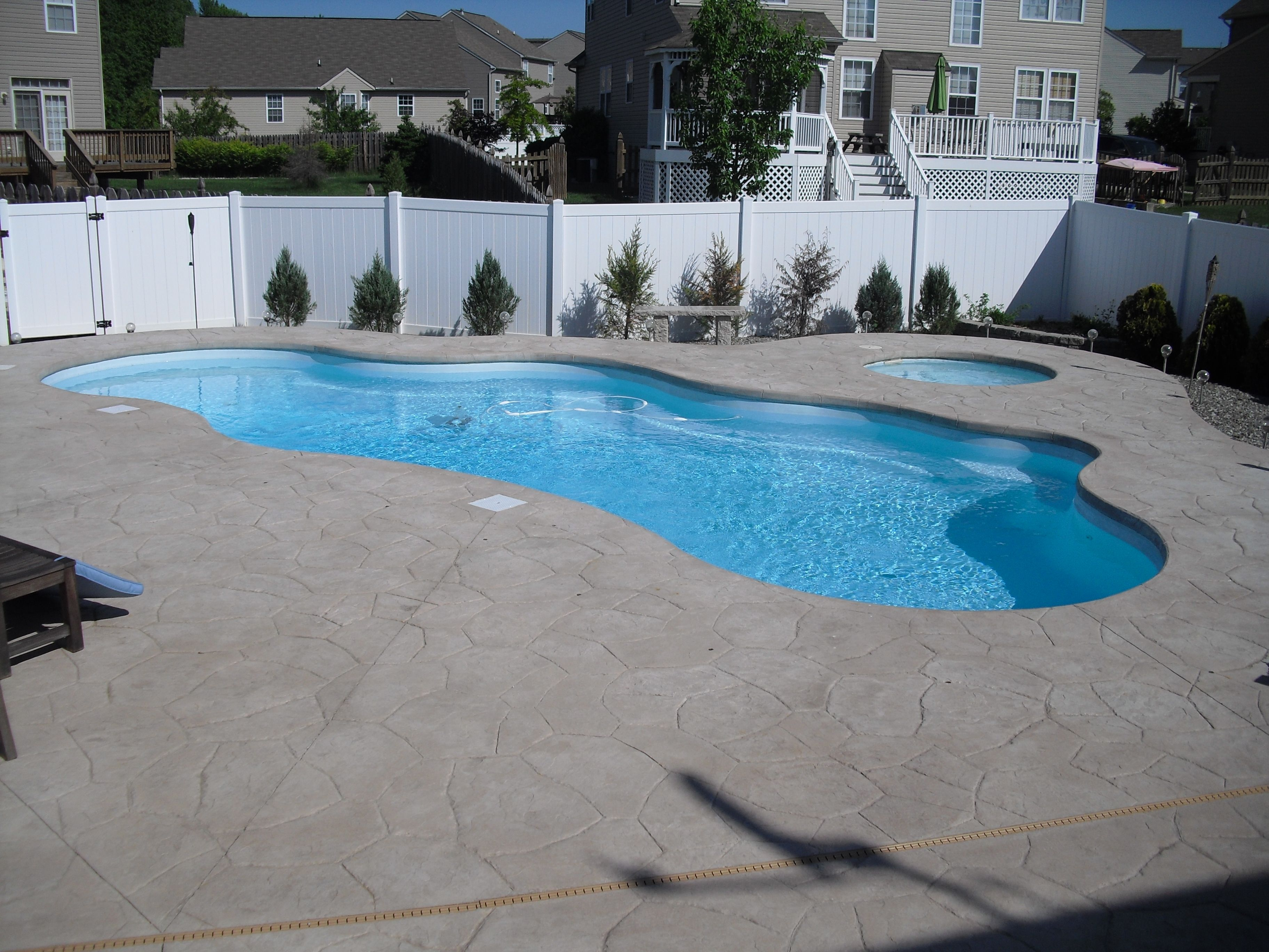 Fiberglass Pool and spa with cantilever deck and stamp Concrete
