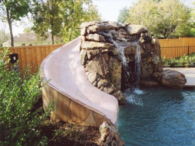 swimming pool cave and waterfall slide