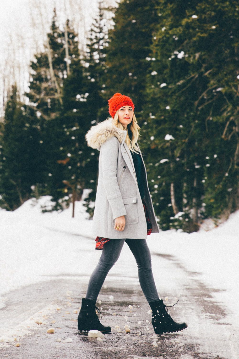 c0ea0c2f5e3e Caitlin Lindquist of the travel blog Dash of Darling wears a winter outfit  in the snow while visiting home in Park City, Utah.