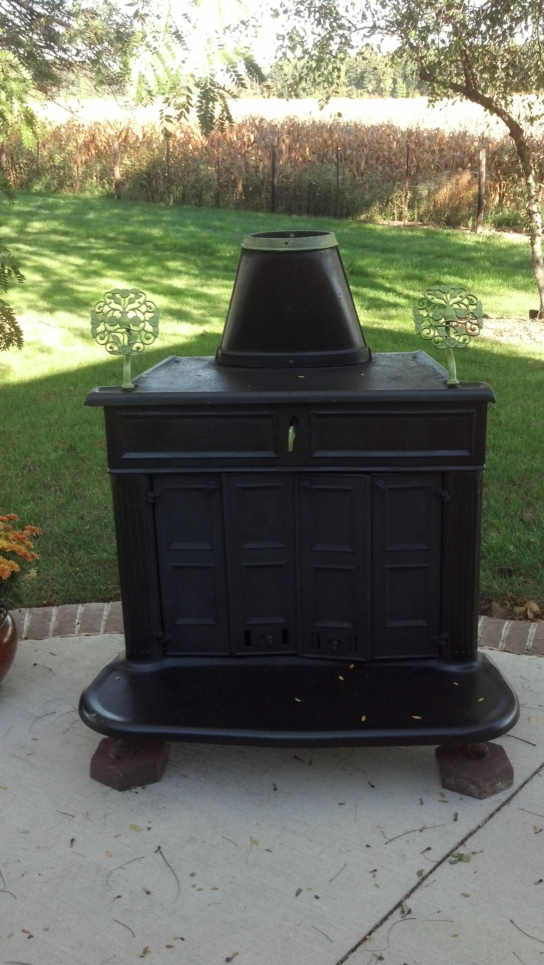 an old wood stove re purposed as an outdoor fire place for my
