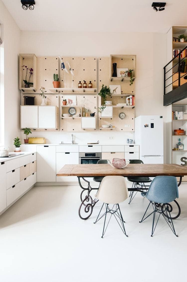 Clean crisp scandinavia style the large pegboard wall units are