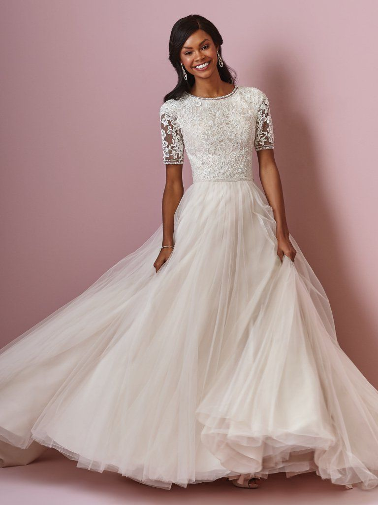 Pearl belt for wedding dress  ELIZA ANNE Beaded lace motifs adorn the bodice of this modest