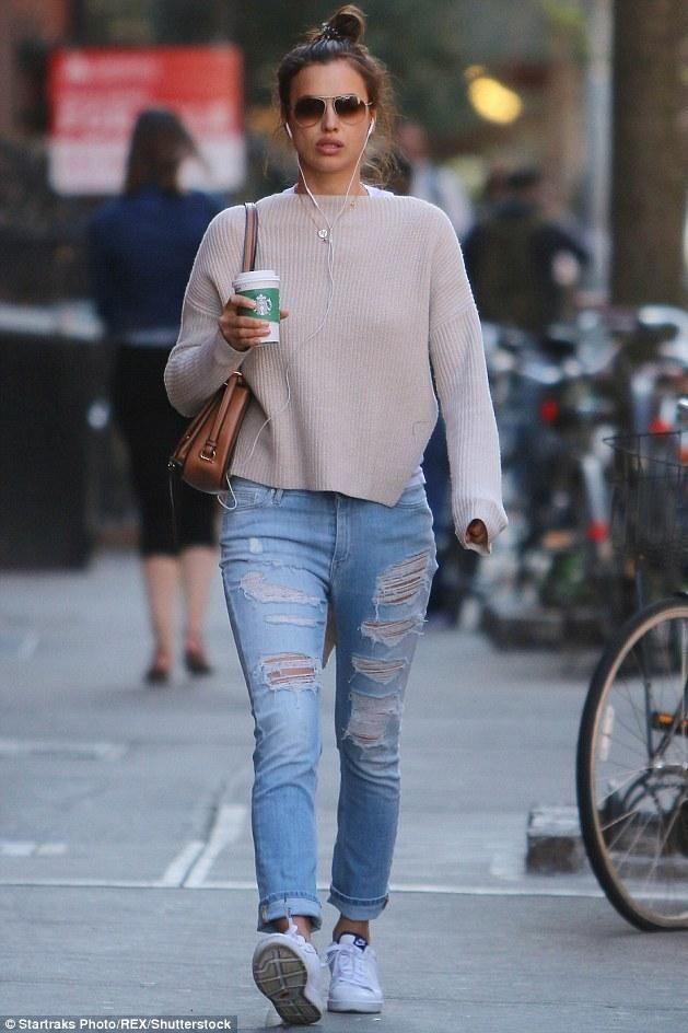 Irina Shayk wearing Nike Tennis Classic Ultra Fo Sneakers, Miu Miu Pre-Fall 2016 Bag and IRO Mandy Distressed Boyfriend Jeans