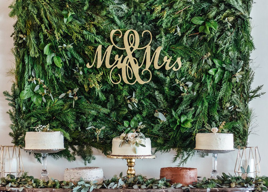 We loved building this greenery wall for this Winter Wedding! The ...